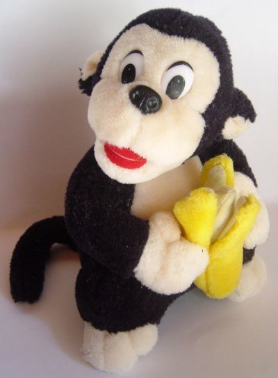 1049114_090602145412_Monkey_with_Banana1
