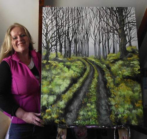 Cherie Roe Dirksen with her painting 'Mysterious Unknown'