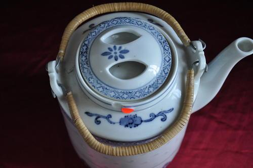 Oriental Porcelain Oriental Tea Pot With Wicker Basket