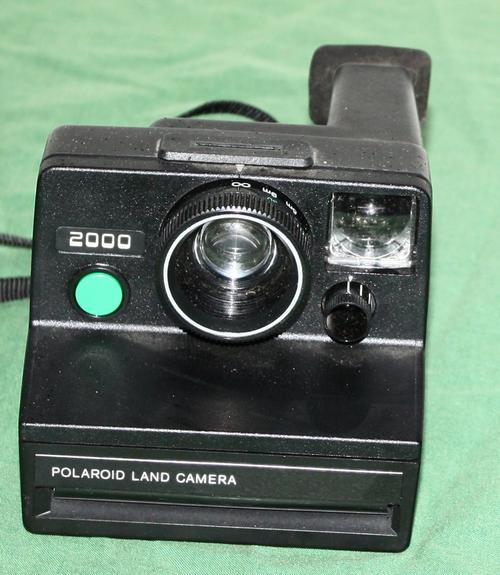 instant polaroid polaroid land camera 2000 was sold for on 2 mar at 16 16 by. Black Bedroom Furniture Sets. Home Design Ideas