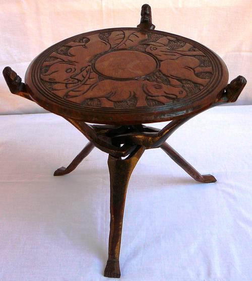 Tables carved african three legged side table was sold for Table th 00 02