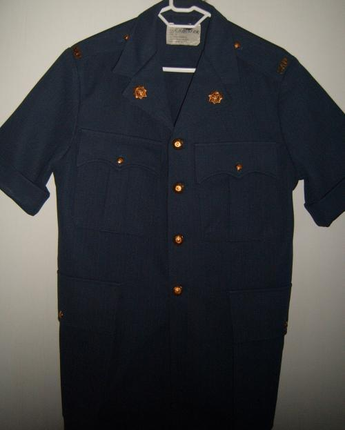 This is an old South African Police Safari Uniform Shirt and consists of :