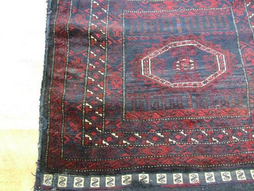 Deep burgundy tribal rug
