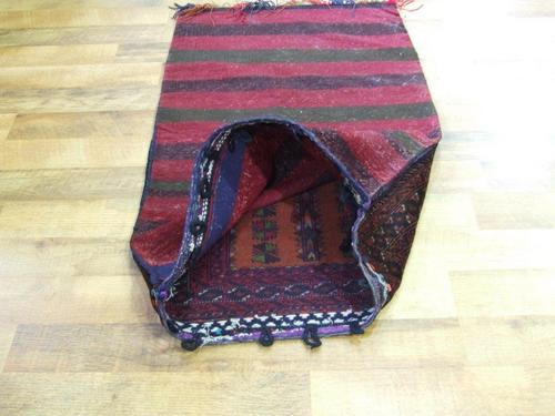 Tribal rug rich warm colours red burgundy