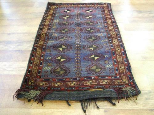 Tribal rug blue deep burgundy orange