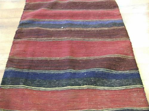 Tribal rug red blue colours