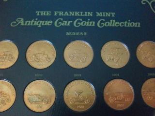 The Franklin Mint collection of antique car coins. by Floyd Clymer